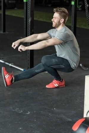 man doing one legged squats