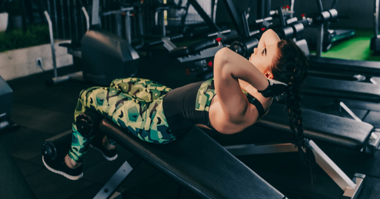 girl doing sit up bench exercise
