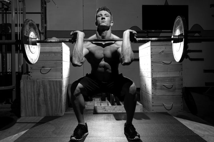 a man doing front squat exercise