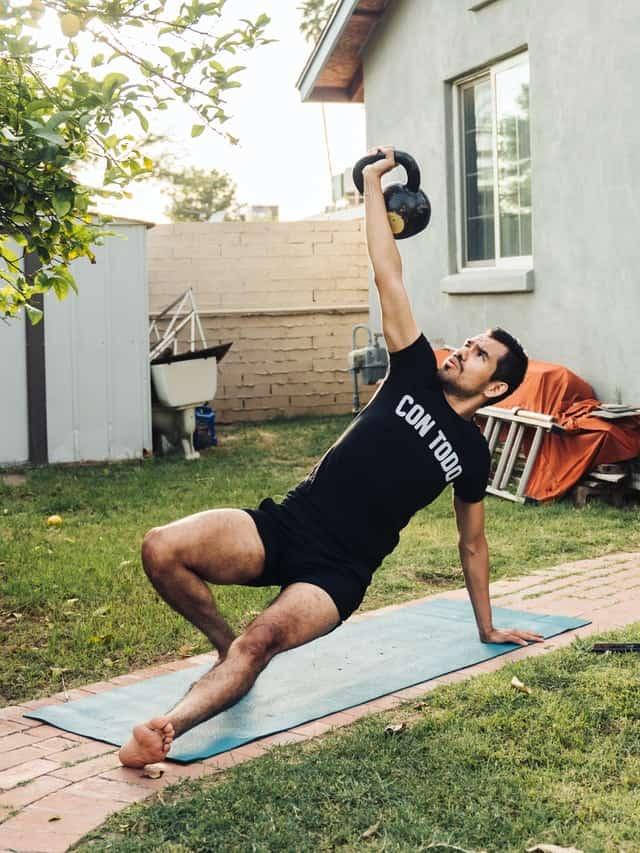 a man doing turkish get up